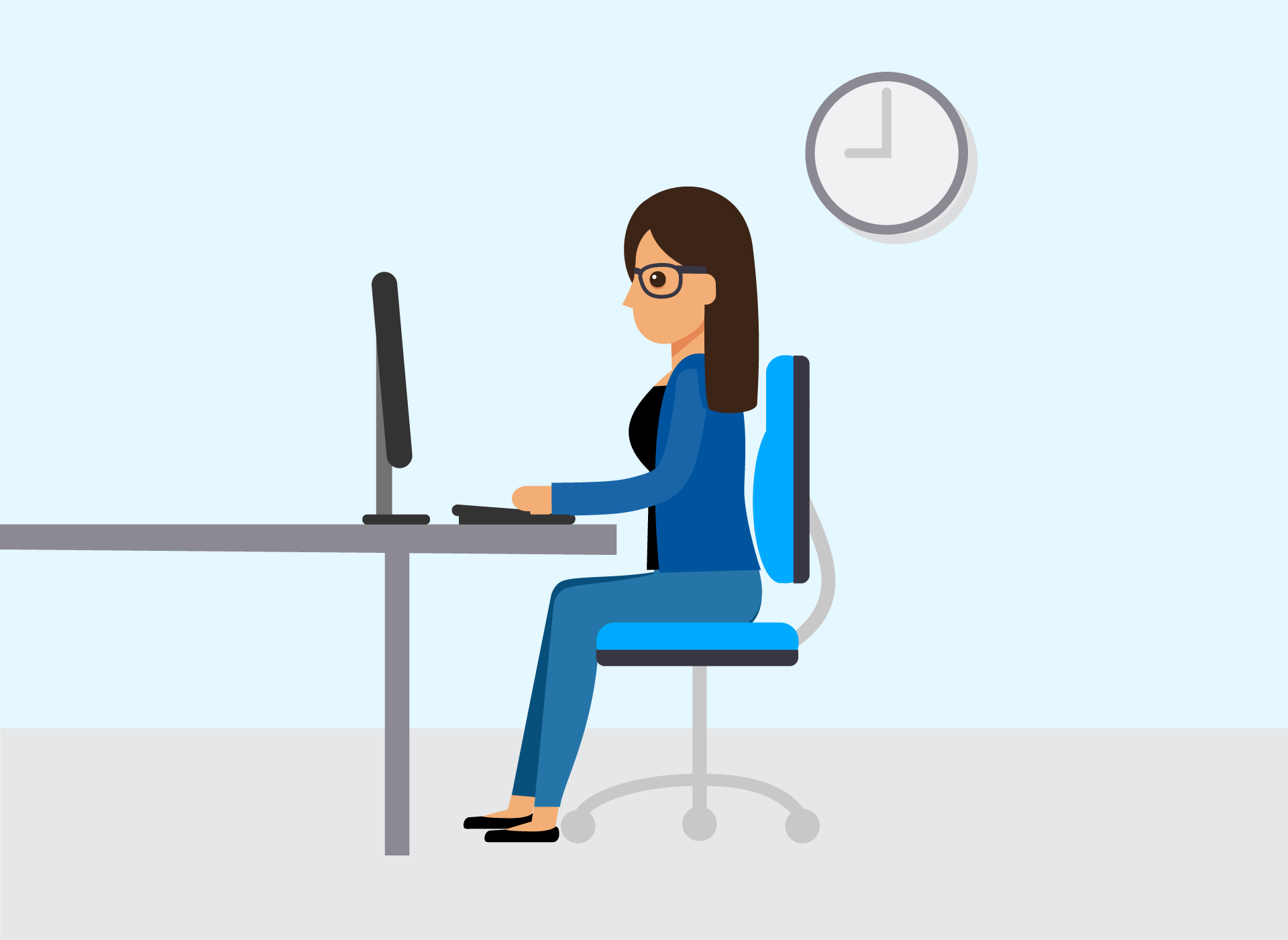 woman sitting at desk working on computer